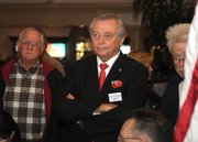 Congressional candidate Chris Mitchum watches for the next round of polling results on election night (Nov. 4, 2014)
