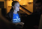 Water Guardians organizer Katie Davis keeps tabs on Measure P results