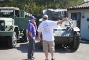 Another veteran briefs Delgadillo on armored units on display at the Salute.