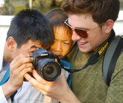 A student sharing the viewfinder with some new friends.