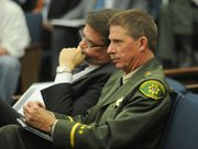 Undersheriff Don Patterson with his boss at Board of Supervisors meeting.