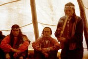 American Indian Movement leaders Dennis Banks (left) and Russell Means, seated, with Lakota medicine man Wallace Black Elk — from <em>Wounded Knee: A Line in the Sand</em>, a Kevin McKiernan film currently in post-production.