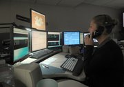 A city dispatcher takes an emergency call.