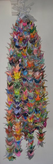 Strings of origami cranes have passed from tragedy to tragedy.