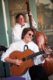 <b>HOT: </b> Dave Collert played his favorite Jacques Favino guitar with his Hot Club Band in 2013.
