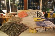 KKIBO knits (left) alongside textiles from Gravel & Gold