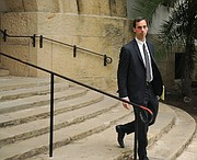Attorney Tim Hale leaves the Santa Barbara Courthouse. (Jan. 26, 2015)