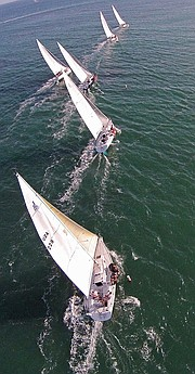 A fleet of sailboats photographed by an UAS.