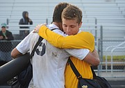 DPHS mens soccer loses to Los Alimitos (Feb. 20, 2015)Dos Pueblos soccer captain Tim Heiduk (5) and goalkeeper Alex Mathews console each other after their high school careers came to an end in a 1-0 loss to Los Alamitos.
