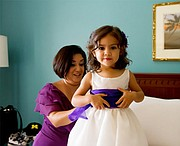The bride's sister Claudia Marquez and the couple's niece Ariana Laguna Marquez get ready.