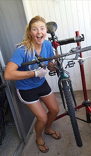 Bren Lanphear at Bici, working on her bike