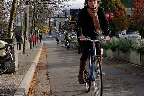 A bike lane separated from cars adds safety in Vancouver, Canada.