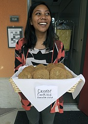 """Bren School student Jennifer Sajor gets ready to pass out """"Chocolate Chirp"""" cricket cookies."""