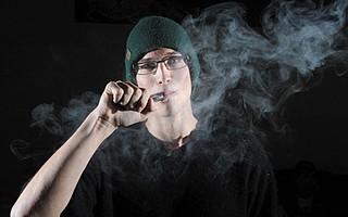 Collin Walker at Santa Barbara Vapor puffs away at his e-cigarette.
