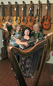 <b>Folk Mote Music mavens:</b> (from left) Laurie Rasmussen, Nadine Bunn, and Cherie Chako