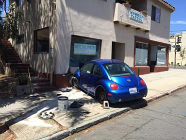 This Beetle ran into a building on West Mission after exiting a driveway.