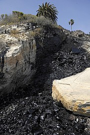 Oil from an onshore leak spills down the cliff and into the ocean north of Refugio Beach (May 19, 2015)