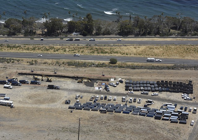 On Day 4 post-spill, the site of the broken crude pipeline at Refugio held dozens of bins of contaminated soil.