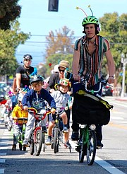 Dru van Hengel leads a kids fun ride in Santa Monica.