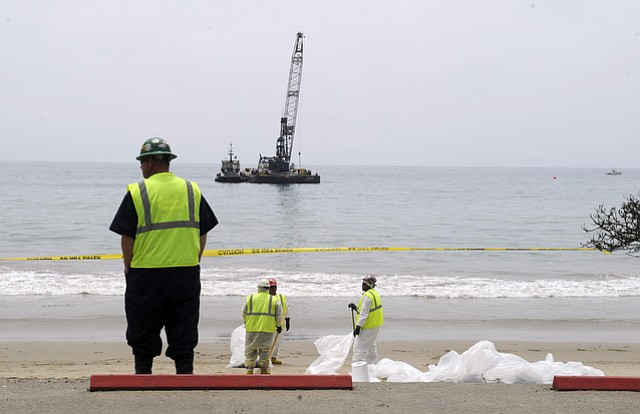 Crewmembers work on Refugio Beach cleanup. (May 29, 2015)