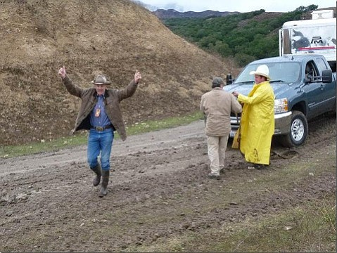"""Josiah Jenkins, in the yellow slicker, recalls that Willy Chamberlin came along to where the Santa Barbara Trail Riders were camping on the Chamberlin Ranch one rainy November day in 2010. """"Willy went and got one of their tractors to pull everyone out, that is, up and over the hill from the campsite to paved roads."""" Mourning the loss of his friend, Jenkins wrote, """"We have lost a great statesman, rider, teacher, mentor, and, above all, a true gentleman."""""""