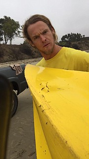 Connor Lyon models kayak battle wounds.