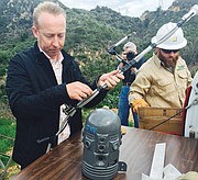 <b>SMELL TEST:</b>  FlameSniffer CEO Cam McKenna (left) and Southern California Edison crews install FlameSniffer sensors in Mission Canyon.