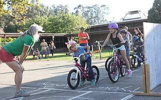 Students at Vieja Valley school's Bici Familia practice looking both ways before pedaling.
