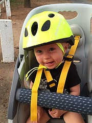 Alexander, at 16 months old, is ready to ride.