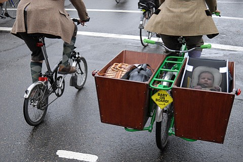 Though the American Academy of Pediatrics advises waiting till a child is one before going pedaling, this Portland family found a way to carry their baby on the Tweed Ride.