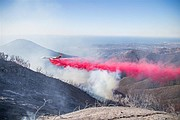 Fire Retardant lays down a barrier between Montecito Peak and the fire line.