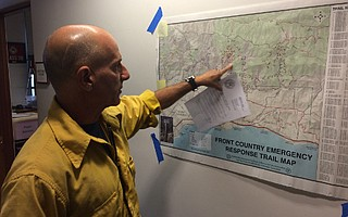 At the Gibraltar Fire incident command, County Fire's Capt. Dave Zaniboni points to the approximate location of the blaze.