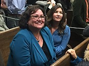 Cathy Murillo (foreground) sits with Andria Martinez Cohen