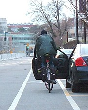 """An abruptly opened car door spells doom for bicycle riders. They must either swerve into traffic or get """"doored."""""""