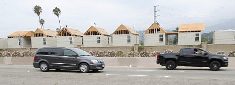 """The """"mobile homes"""" along Punta Gorda Street that overlook Highway 101 have generated sustained outrage from some in Santa Barbara's community."""