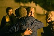 Rev. Julia Hamilton hugs Hilary Peatte after the vigil