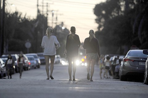 As in most residential areas, Isla Vista's roadsides are lined with parked cars, but its streets are often clogged with pedestrians, bicycle riders, or skateboarders as well.