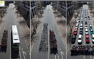 An indication of the space taken by 69 people on a bus, bikes, or cars.