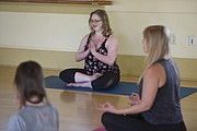 Jessica Parsons, a certified yoga instructor born with down syndrome leads the Inclusive Yoga for All Abilities class at the Carrillo Rec Center (May 15, 2015).