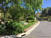 Police tape blocks Greenhill Way leading to the home where three bodies were found.