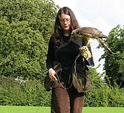 <strong>FEATHERED FRIEND:</strong>  Author Helen Macdonald and her goshawk, Mabel, train on a green behind Cambridge University.