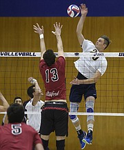 <strong>GAUCHOS ALTOS: </strong>UCSB's Ryan Hardy (#20) leaps high to smash a set from Jonah Seif over Stanford's seven-foot middle blocker, Kevin Rakestraw.