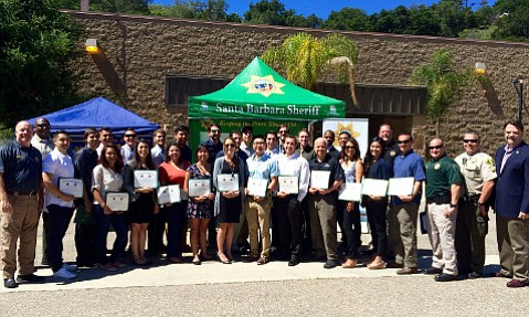 The 32 graduates of the first-ever college student and Isla Vista–resident Citizens Academy received their certificates of completion on Saturday from Sheriff Bill Brown (far right) and UCSB Police Chief Dustin Olson (far left).