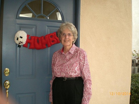 Barbara Massey, longtime Goleta development hawk, has a door decoration that suggests some skepticism of holiday rituals.
