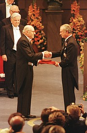 Accepting his 1998 Nobel Prize in chemistry from King Carl XVI Gustaf of Sweden.
