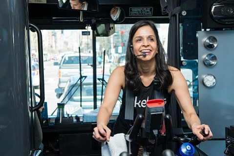 Seema Brodie leads a spin class on Boston's BikeBus, which lets commuters exercise during the ride.