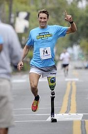 Andre Barbieri celebrated his second-place finish in the amputee division.