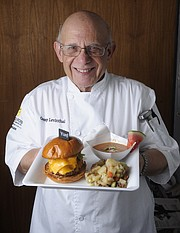 George Levinthal shows off his plate of Grilled watermelon Gazpacho w/ cool cucumber and spicy jalape–o followed by Kick-Ass Cheeseburger. Complementing the burger will be a tangy, mustard and vinegar based potato salad for the Santa Barbara Independent's 7th Annual Sizzling Summer BBQ Contest