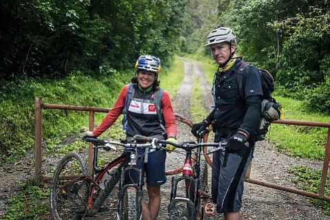 Rebecca Rusch and Patrick Sweeney rest after completing their extraordinary ride up Mt. Kilimanjaro.