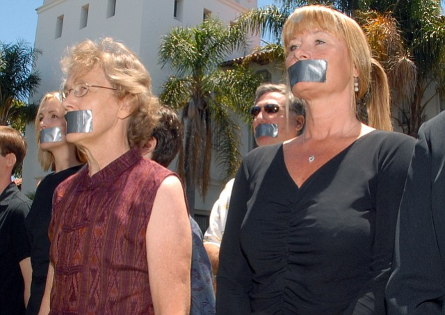 Melinda Burns (left) and Dawn Hobbs, along with many News-Pressers, placed duct tape over their mouths during a protest in 2006.